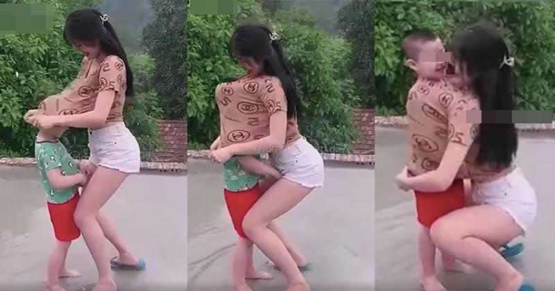 Cô gái đang cùng bé trai vui đùa thì có hành động bất ngờ khiến ai nấy đều phẫn nộ: Đừng đem con nít ra làm trò câu view - Ảnh 1.
