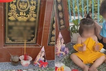 Bức hình thu hút 63 nghìn like: Bố đưa hai con ra mộ chúc mừng sinh nhật mẹ