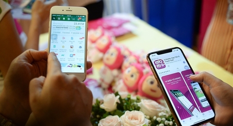 E-wallet firms battle for slice of cashless payment pie