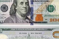 Mang 1.000 tờ USD giả mệnh giá đến ngân hàng đổi