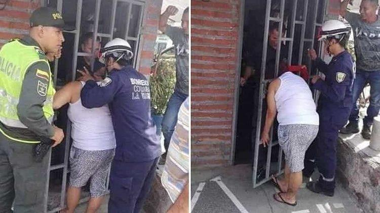 Ngó nghiêng nhà hàng xóm, phụ nữ bị mắc kẹt đầu vào song cửa - 1