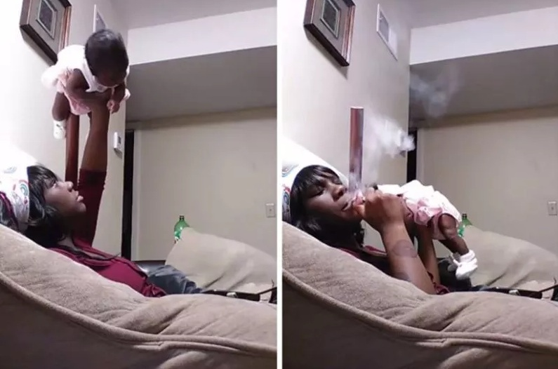 Phẫn nộ người mẹ bế con 1 tuổi như nâng tạ trong khi tay phì phèo điếu thuốc - 1