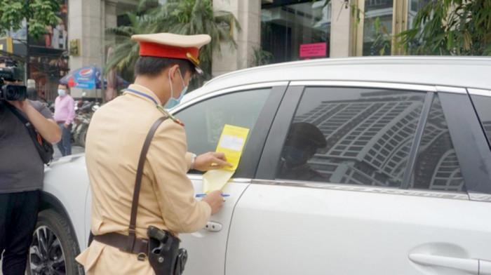 Xe bị dán giấy phạt nguội, phải làm thế nào? 1