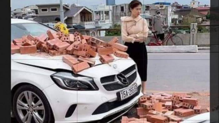 Hành động đẹp của nữ tài xế Mercedes sau va chạm với xe ba gác chở gạch 1