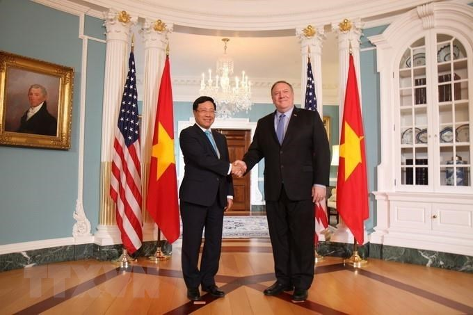 US Secretary of State Mike Pompeo welcomes and holds talks with Deputy Prime Minister and Foreign Minister Pham Binh Minh during his official visit to the US from May 22-23, 2019 (Photo: VNA)
