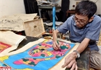 Last descendant making Hang Trong folk paintings