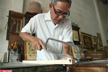 Artist shows Vietnamese spirit in marquetry pictures