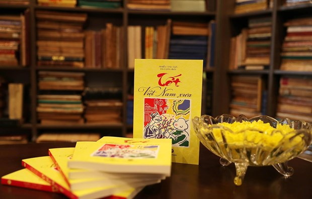 Tet in olden days through the eyes of Vietnamese, French scholars hinh anh 1
