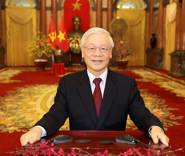 Top leader offers Tet greetings hinh anh 1