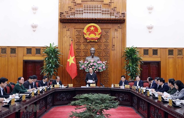 Vietnam doing well in COVID-19 fight: PM Phuc hinh anh 1