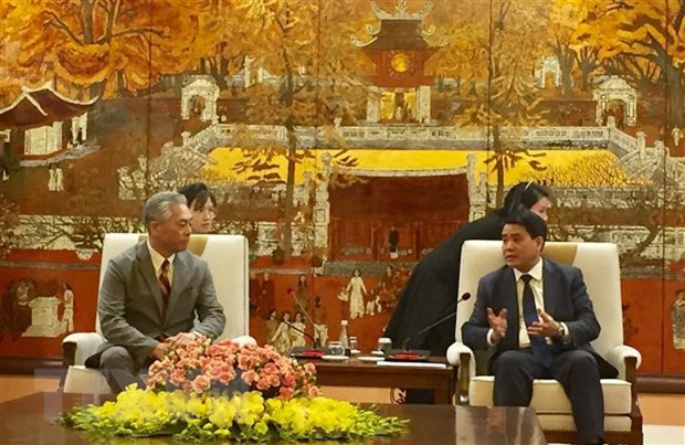 Hanoi leader pledges best conditions for Japan's Uniqlo hinh anh 1