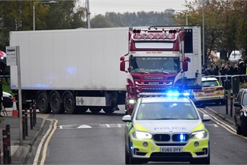 UK police charge another over Essex lorry deaths