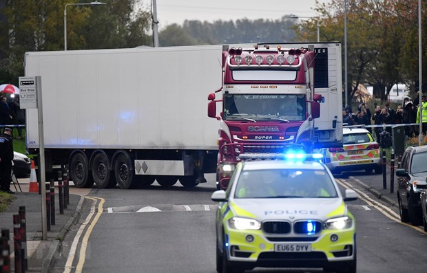 UK police charge another over Essex lorry deaths hinh anh 1