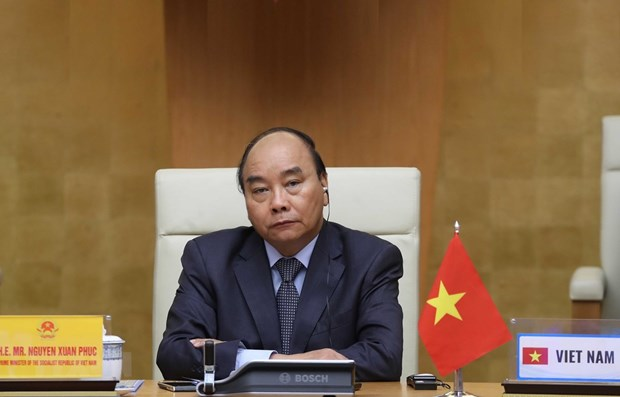 PM joins G20 leaders' video conference on COVID-19 combat hinh anh 1
