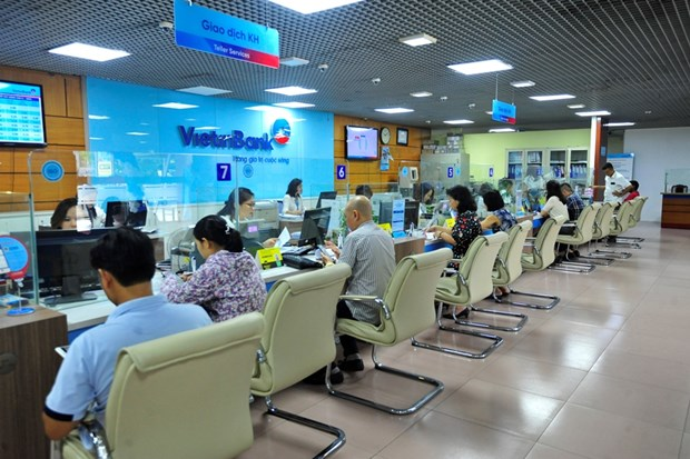 Banks to offer credit packages for customers affected by COVID-19 hinh anh 1
