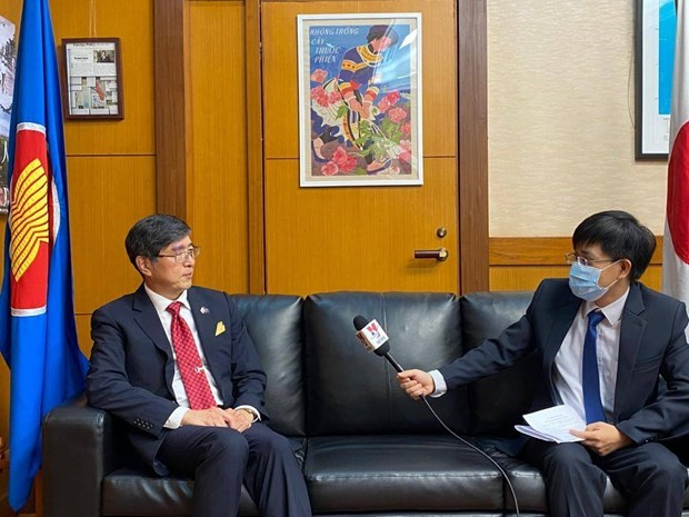 Japan underlines need for information sharing to fight COVID-19 hinh anh 1