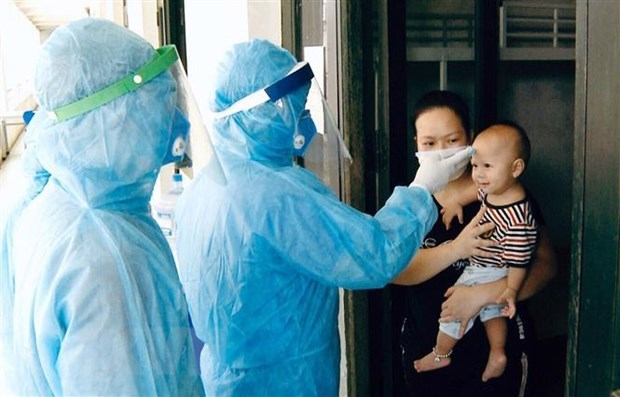 Vietnam believes world will soon put pandemic under control: spokeswoman hinh anh 1