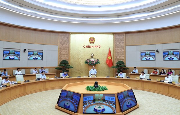 PM chairs meeting on development of key EZs hinh anh 1