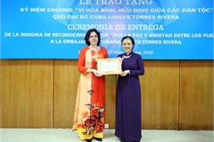 """Cuban Ambassador receives """"For peace and friendship among nations"""" insignia"""