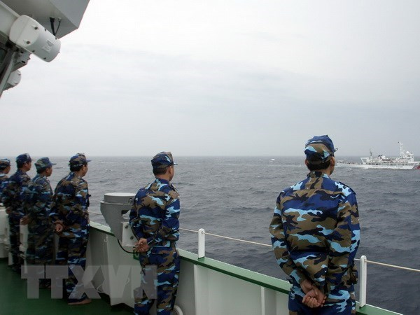 Vietnam, China hold new round of talks on sea-related issues hinh anh 1