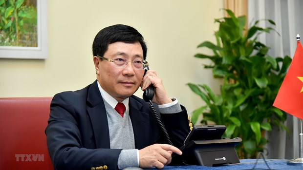 Deputy PM, FM Pham Binh Minh holds phone talks with US State Secretary Antony Blinken hinh anh 1