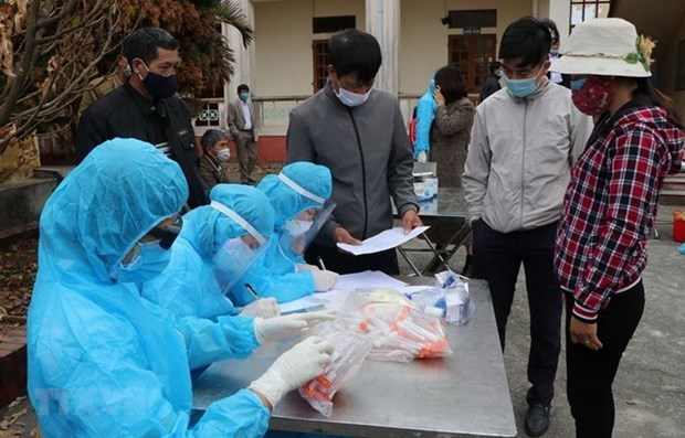 Vietnam records 33 new COVID-19 cases on February 14 evening hinh anh 1