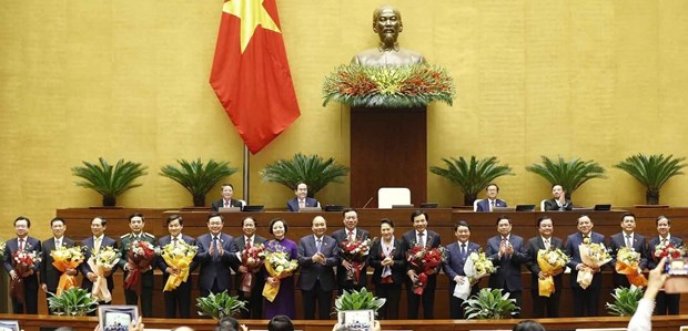 NA approves appointment of 12 new ministers, Gov't members hinh anh 1