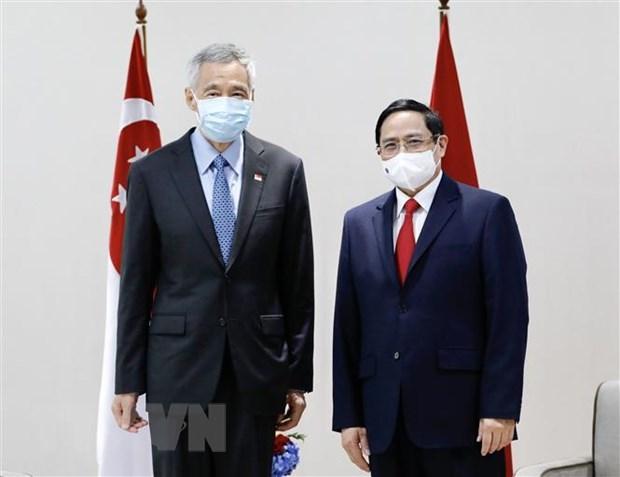 PM meets Cambodian, Singaporean, Malaysian counterparts hinh anh 2