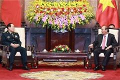 Armies' successful ties help reinforce Vietnam-China relations: President
