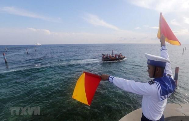Vietnam resolutely rejects China's unilateral fishing ban: Deputy Spokesman hinh anh 1