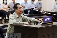 Ex-minister of industry and trade gets 11-year jail sentence