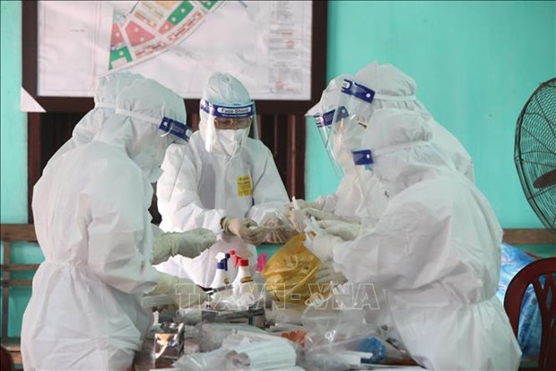Vietnam sees 37 new domestic COVID-19 infections in 12 hours hinh anh 1