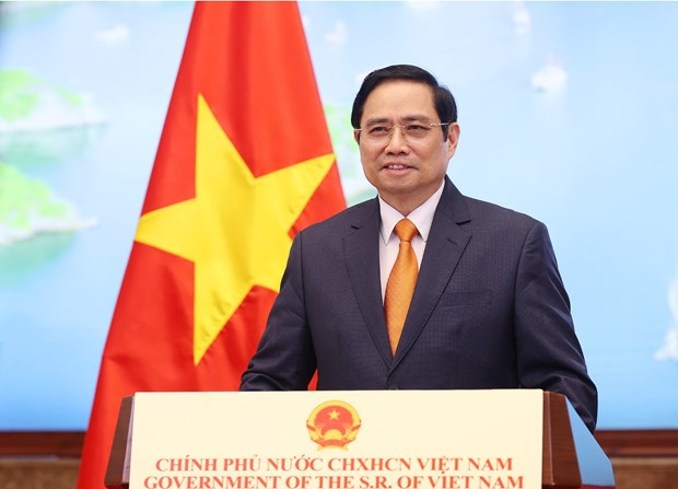Remarks by Prime Minister Pham Minh Chinh at 2021 Global Trade in Services Summit hinh anh 1
