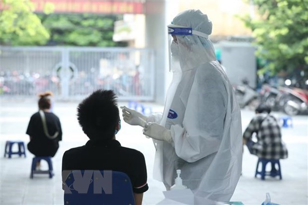 Vietnam logs 14,208 new COVID-19 cases on September 7 hinh anh 1