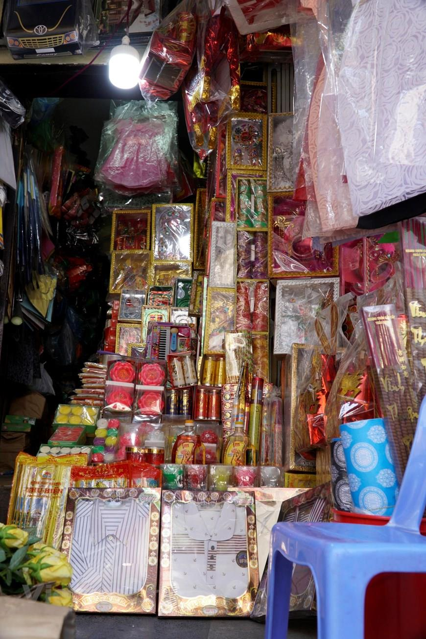 A votive paper shop owner reveals that this year's market is gloomy compared to previous years (Photo:VNA)