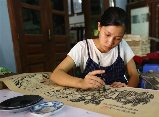 Dong Ho painting or Dong Ho folk woodcut painting is a genre of Vietnamese folk paining, stemming from Dong Ho village (Dong Ho commune, Thuan Thanh district, Bac Ninh province) (Photo:VNA)