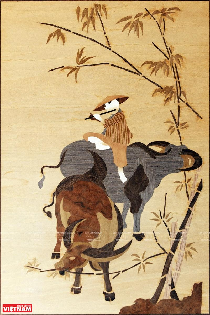 The themes of Ky's marquetry pictures are diverse, but a large part of them is about the natural scenery and people of Vietnam (Photo: VNA)