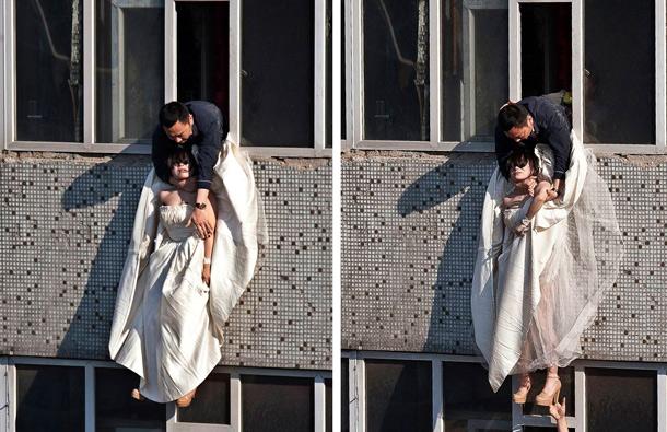 Cô gái mặc váy cưới nhảy khỏi tòa nhà, cuộc giải cứu nghẹt thở trong 54 giây và bức ảnh đạt giải thưởng gây xúc động mạnh - Ảnh 5.
