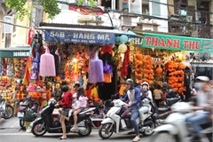 Halloween atmosphere floods Hanoi street