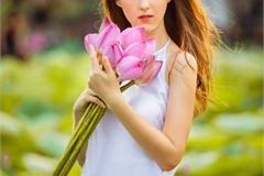 Ukrainian model poses with Hanoi lotus flowers