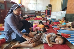 Nun takes care of hundreds of orphanage children