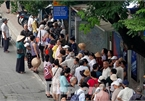 Hanoi: Hundreds of old people queue to get free bus pass