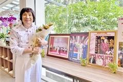 Photo exhibition features career of veteran cải lương performer