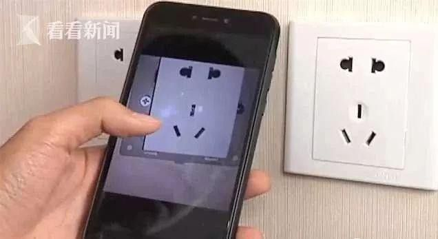 Cặp đôi phát hiện camera quay lén giấu trong ổ điện khách sạn - 3