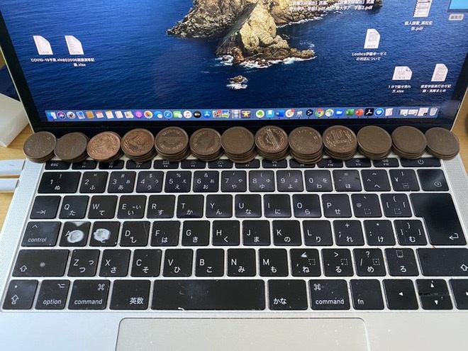 Mẹo làm mát laptop bằng đồng xu, thủ thuật độc đáo hiệu quả ngoài mong đợi - 1
