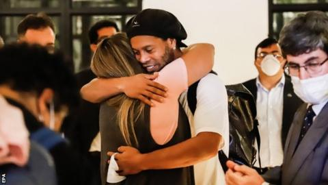 Ronaldinho was met by friends at the hotel he must now stay in in Asuncion