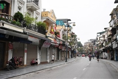 Hanoi streets fall silent ahead of official closure of businesses