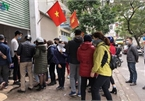 People queue up to buy medical masks at standard price