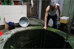 Ageing underground wells in the heart of Hanoi