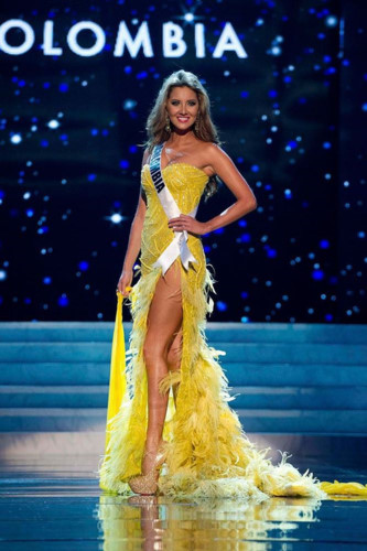 yellow evening gown worn by h'hen nie wins miss universe award hinh 9